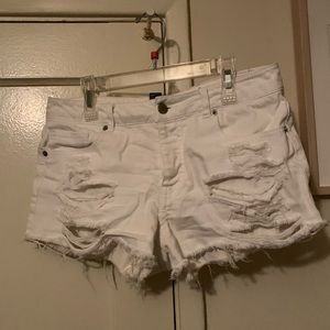 White, destroyed denim shorts